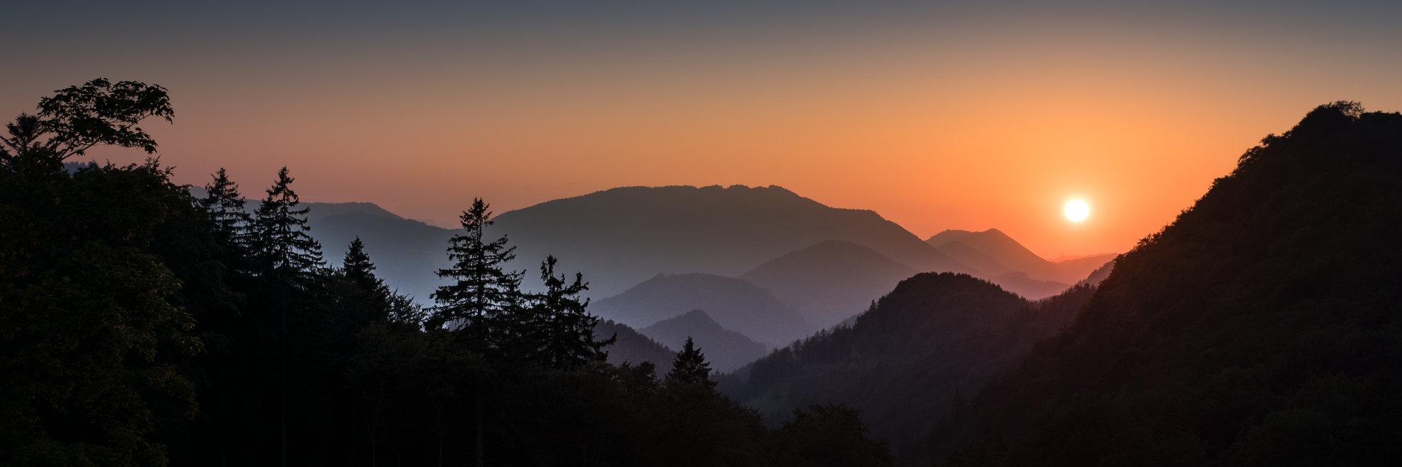 Hintergrundbild Arbeitseise - Hochbärneck Sonnenuntergang - niederer Unternehmensbegleitung